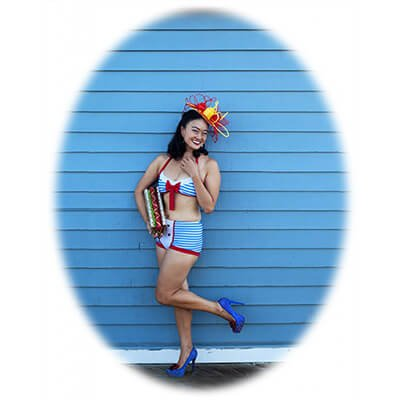 Competitive eater, Mary Bowers accessorizes both food and fashion as a patriotic hotdog pinup